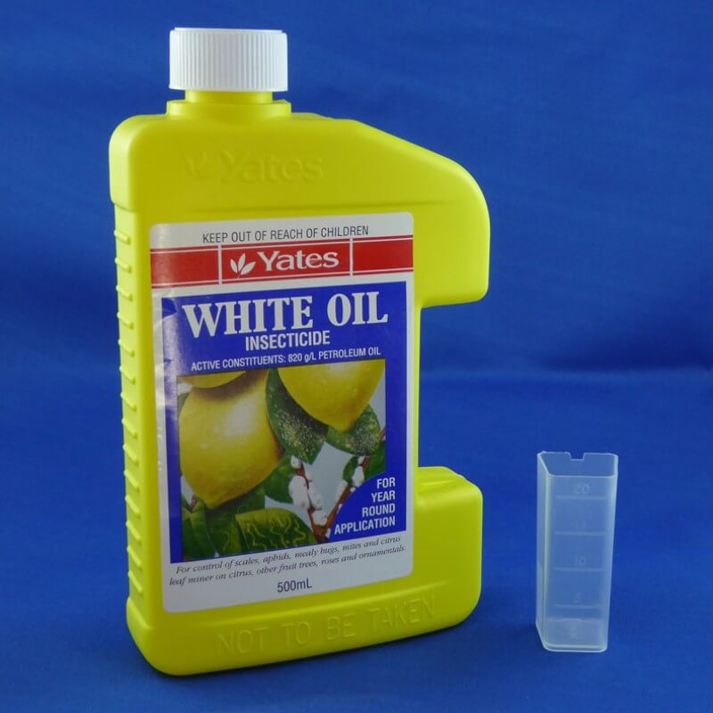 Yates White Oil Insecticide with measure beaker